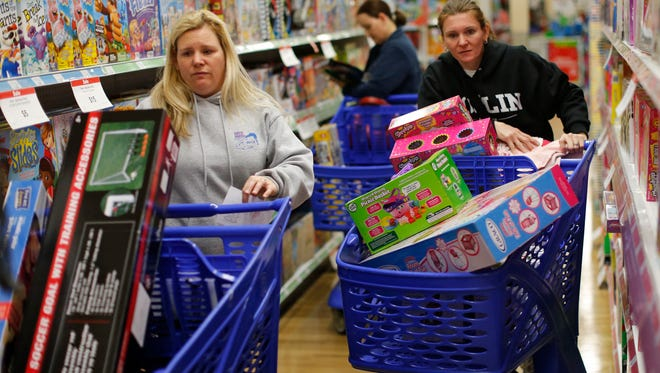 Stacy Levine, left, and Melissa Bragg shop at a Toys R Us in Atlanta on Black Friday in 2015.  Serious deal-seekers are already planning their Thanksgiving weekend shopping.