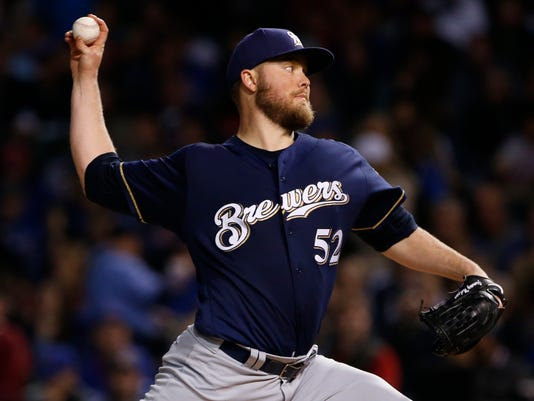 Milwaukee Brewers starting pitcher Jimmy Nelson throws against the Chicago Cubs during the first inning of a baseball game Friday, Sept. 8, 2017, in Chicago. (AP Photo/Nam Y. Huh)