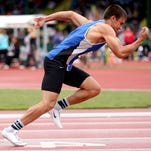 McNary's Kyle Torres competes in the 400 meter dash at the OSAA class 6A track and field state championships at Hayward Field in Eugene on Friday, May 22, 2015.