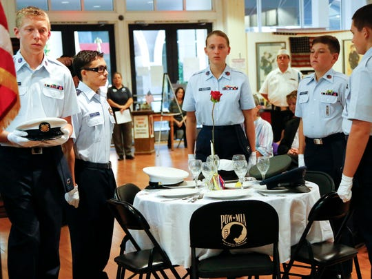 The POW/MIA table ceremony is performed during Friday's gathering in Simi Valley.