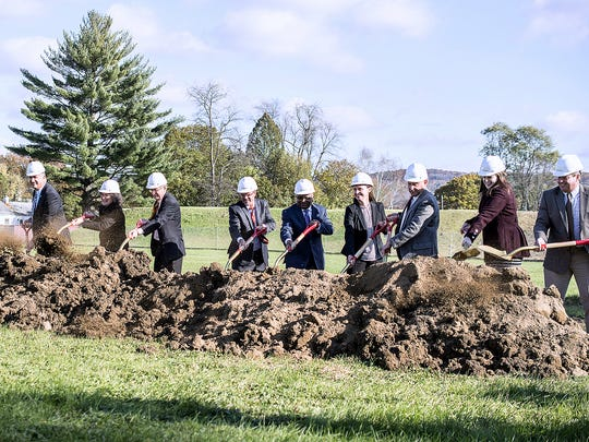 Officials break ground for a new senior housing development on Maple Avenue in Elmira.