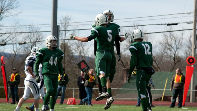 Rice celebrates a touchdown during the Division II championship game against the Fair Haven Slaters in November, 2014.