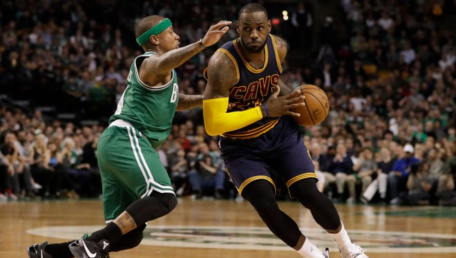 Cleveland Cavaliers forward LeBron James drives the ball against Boston Celtics guard Isaiah Thomas in the first quarter of a regular season game.