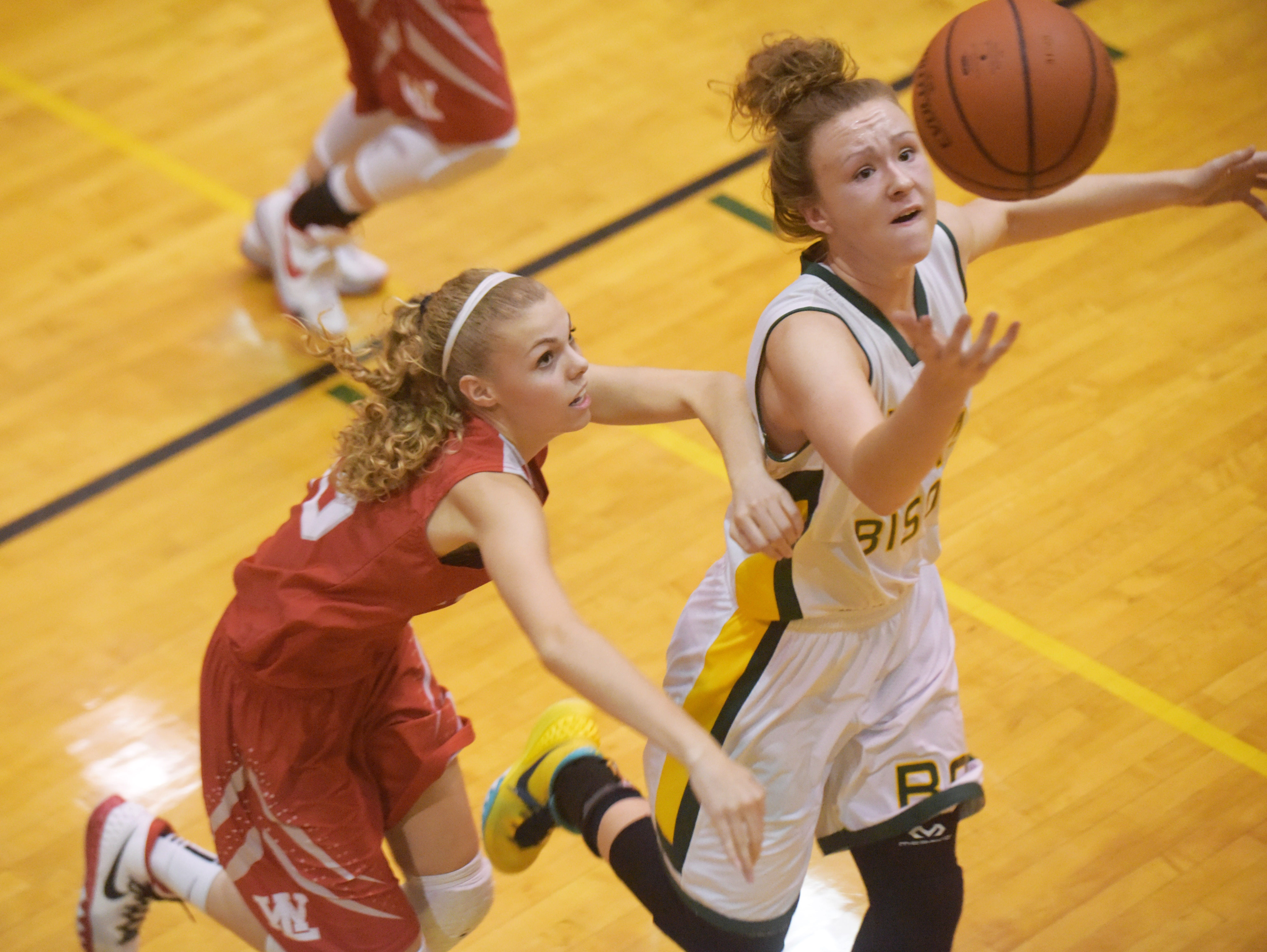 Benton Central's Katie Shields, right, goes for a ball with a West Lafayette defender following Thursday, December 10, 2015 at Benton Central High School. Benton Central was victorious over West Lafayette.