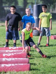 Marshall 5th grader Owen Valintine does agility drills