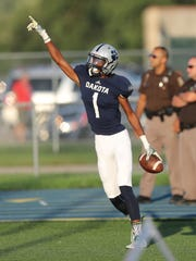 Macomb Dakota's Jaylen Hall catches a touchdown pass during the first half of Dakota's 35-28 win Thursday in Macomb.