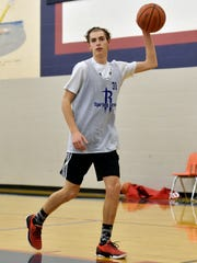 Spring Grove's Drew Gordon looks to pass the ball during