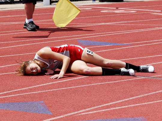 An exhausted Anna Foster, of Sheridan, lies on the track shortly after winning the 3200 meters during the Division II state track and field meet at Ohio State's Jesse Owens Memorial Stadium. Foster set a new meet, school and personal record in 10:34.3.