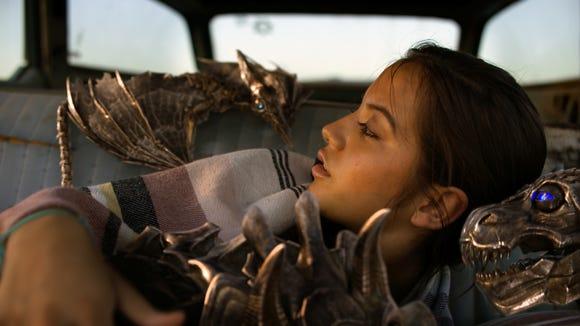 Izabella (Isabela Moner) wakes up to a bunch of mini-Dinobots