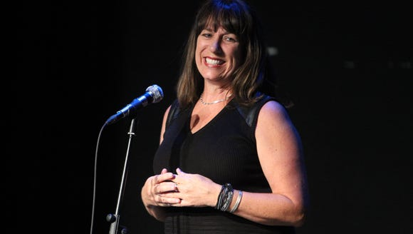 Karina Bland, seen here hosting the Storytellers Project