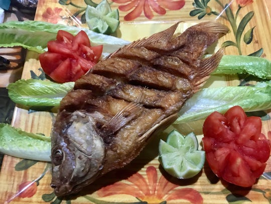 A whole tilapia ($15.99) fried and served with rice,