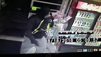 Photo from store surveillance camera of suspect in armed robbery at One Stop Store in Bay Township.