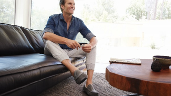 Tom Brady shows off his UGG slippers.