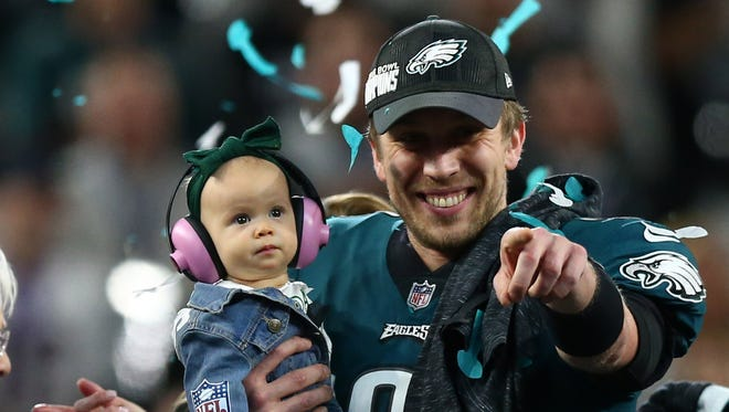 Philadelphia Eagles quarterback Nick Foles (9) celebrates with daughter Lily after defeating the New England Patriots in Super Bowl LII at U.S. Bank Stadium.