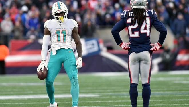 Dolphins wide receiver DeVante Parker (11) reacts in front of Patriots cornerback Stephon Gilmore after making a catch for a first down during Week 17 last season.