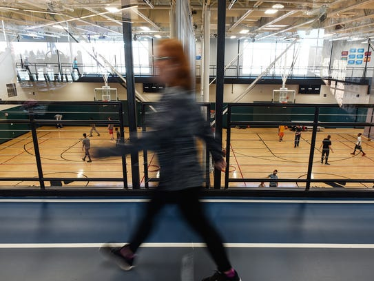 A walking tack circles the busy basketball courts as