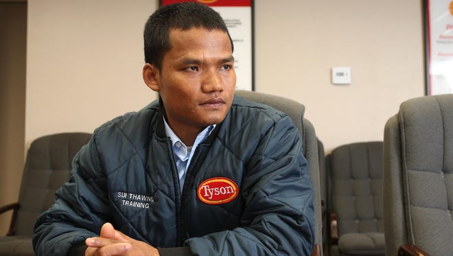 Sui Thawng, a refugee from Burma, found a good job as a supervisor at Tyson Foods in Waterloo. The meatpacking plant has been an employment landing place for many of Waterloo's 1,200 to 1,500 Burmese refugees, including Thawng's wife.