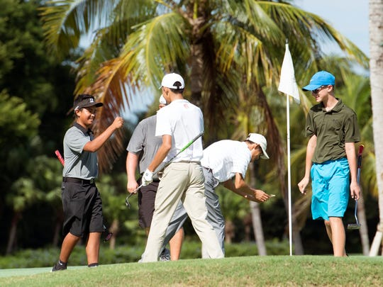 Junior golfers from China play a match against juniors from The First Tee of Naples/Collier at Grey Oaks in Naples, Fla., on Wednesday, Aug. 9, 2017.