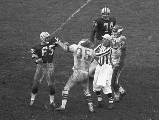 Green Bay Packers linebacker Tom Bettis (65) grabs