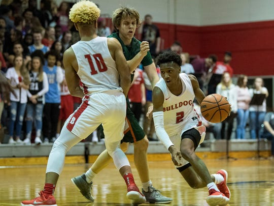 Bosse's Javen Layne (10) screens Vincennes Lincoln's Sam Corrona (11) as Bosse's Mekhi Lairy (2) dribbles to the net at Bosse High School in Evansville, Ind., Saturday, Jan. 27, 2018. The Alices defeated the Bulldogs, 85-82.