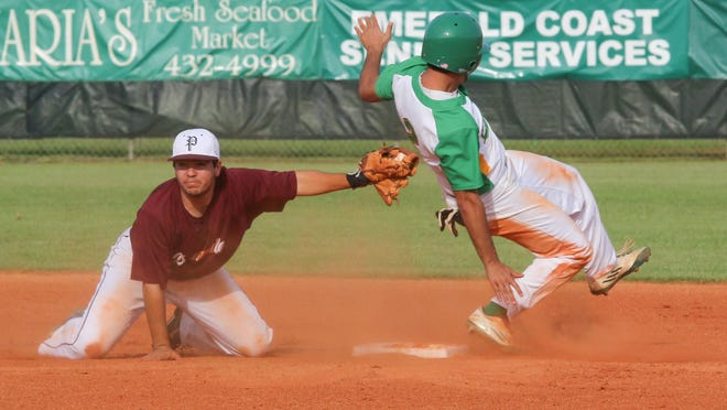 Choctaw's Cole Crews (2) slides safely into second base after Pensacola's Dante Navarro can't tag him in time Tuesday afternoon during game two of the District 1-6A baseball championship playoffs at Gulf Breeze High School.