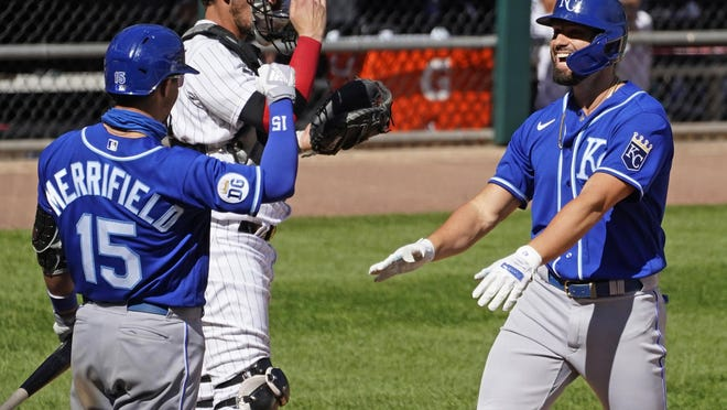 Kansas City Royals' Ryan McBroom, right, smiles as he celebrates with Whit Merrifield after hitting a solo home run during a game against the Chicago White Sox on Saturday in Chicago.
