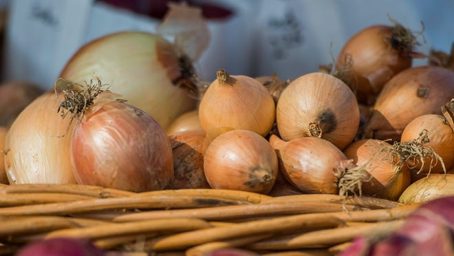 An assortment of onions are seen at the Richmond Farmers Market at Elstro Plaza on Tuesday, Sept. 5, 2017.