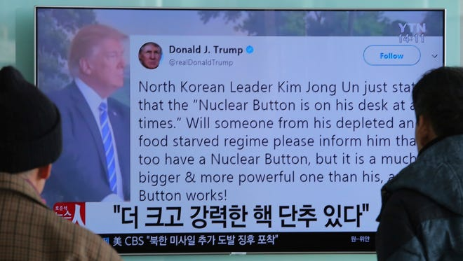 "People watch a TV news program showing the Twitter post of U.S. President Donald Trump while reporting North Korea's nuclear issue, at Seoul Railway Station in Seoul, South Korea, Wednesday, Jan. 3, 2018. Trump boasted that he has a bigger and more powerful ""nuclear button"" than North Korean leader Kim Jong Un does — but the president doesn't actually have a physical button. The letters on the screen read: ""More powerful nuclear button."" (AP Photo/Ahn Young-joon)"