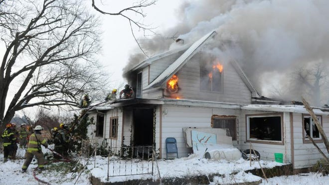 Crews fight a fire at an Allegan County home on Dec. 27, 2020.