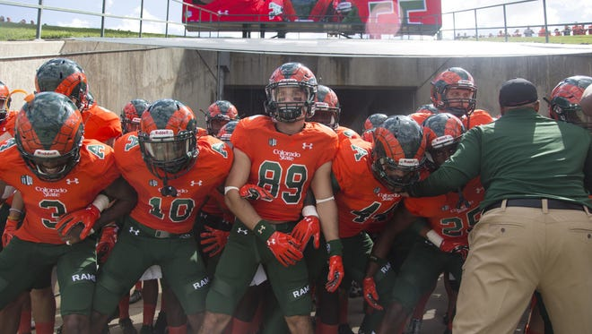 CSU football players prepare to take the field for a game in this file photo.