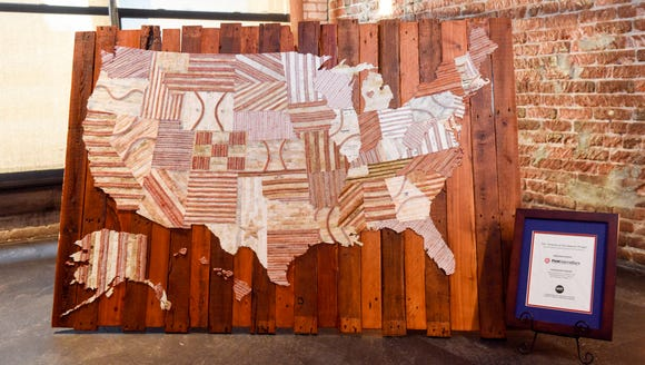 A five-foot-wide U.S. map consisting of reclaimed baseballs