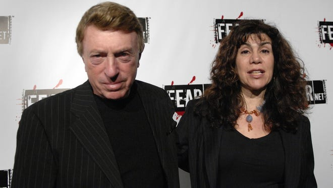 This Oct. 30, 2006, file photo shows writer, director Larry Cohen, left, and wife Cynthia Cohen arriving for the Comcast, Sony and Lionsgate launch party for FEARnet, a multi-platform network dedicated to horror, held at the Boulevard 3 nightclub in Los Angeles.