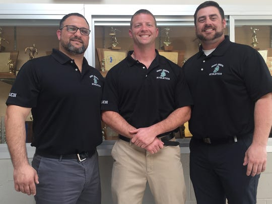 From left to right, St. Joseph assistant wrestling