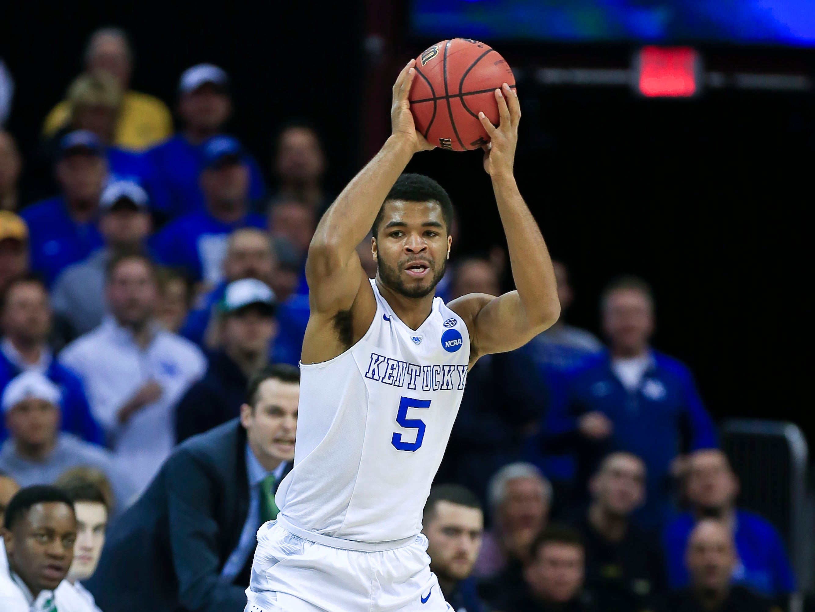Kentucky's Andrew Harrison looks to pass over Notre Dame's Demetrius Jackson during Elite Eight game at Cleveland's Quicken Loans Arena. March 28, 2015 By Matt Stone, The C-J