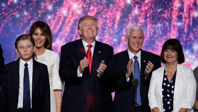 Republican Presidential Candidate Donald Trump and Republican Vice Presidential Nominee Gov. Mike Pence of Indiana stand with (L-R) Barron Trump, Melania Trump and Karen Pence at the conclusion of the Republican National Convention in Cleveland, Thursday, July 21, 2016.