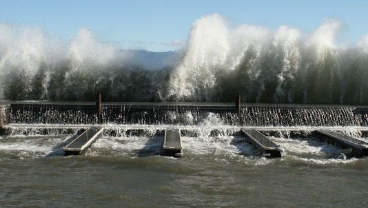 Large waves pushed by a strong easterly wind break against Lake Tahoe's Obexer's Marina in December 2011. Large waves are expected at Tahoe by Thursday.