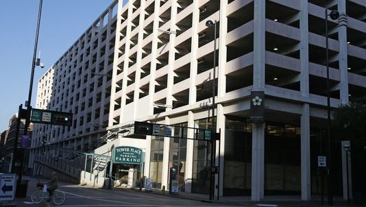 New high-end apartments, a parking garage and commercial space are still envisioned to replace the former Pogue's garage at Fourth and Race streets after a city and developer compromised on a slimmed-down project.