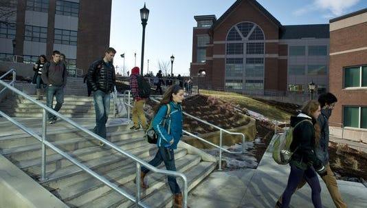 Students cross the University of Vermont campus in Burlington