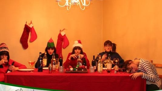 Bridget drinks away her Christmas blues, with four other versions of herself, on her 2012 Christmas card.