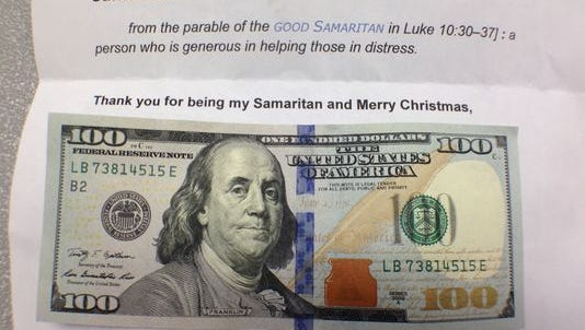 CityBus driver Mike Pattengale received this note and a $100 bill from three good Samaritans who distributed more than $1,300 to bus passengers and people standing near the Third Street transfer station in downtown Lafayette on Tuesday, December 23, 2014. The note asks recipients to buy something they wouldn't normally purchase this Christmas and to help a stranger next Christmas.