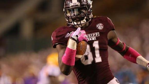 Mississippi State wide receiver De'Runnya Wilson scores