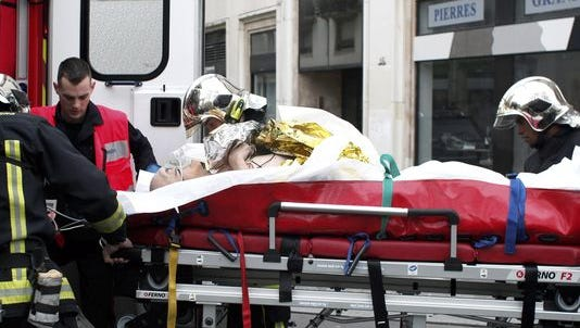 A victim of Wednesday's terror attack in Paris being loaded into an ambulance.