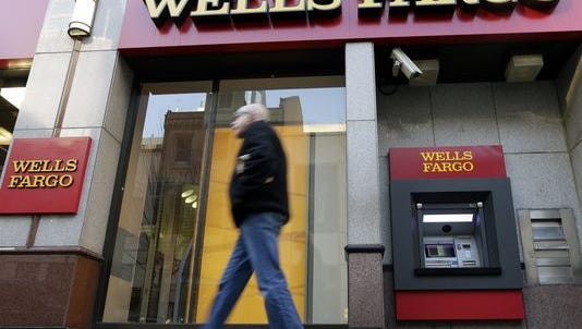 Wells Fargo reported a 5 percent increase in earnings for 2014.