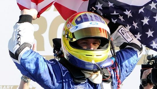 A.J. Allmendinger celebrates in Victory Lane after winning the Rolex 24 at Daytona International Speedway in 2012.