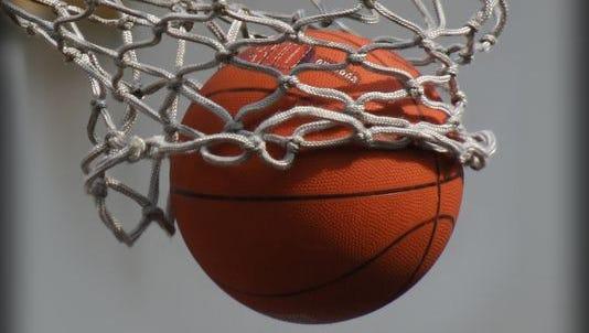 A basketball flows through the hoop.