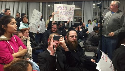 Public and private school supporters clash at an East Ramapo school board meeting in Dec. 2014.