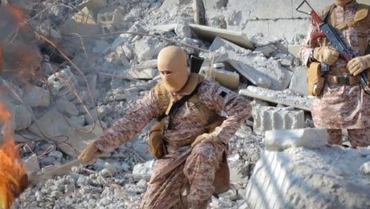 Islamic State militants wore matching digital camouflage uniforms in their latest gruesome execution video, released Tuesday.