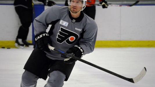 Philadelphia Flyers defenseman Kimmo Timonen skates at practice.