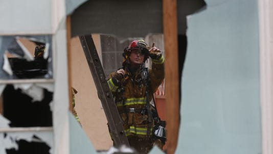 A Palm Springs Fire Department firefighter inspects an apartment complex fire on South Palm Canyon Drive caused damaged to units causing injuries to individuals inside the complex.