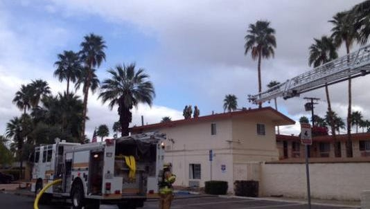 Palm Springs firefighters at the scene of a fire at Knights Inn on South Palm Canyon Drive. Four people were injured in a butane honey oil explosion in one of the rooms, police said.